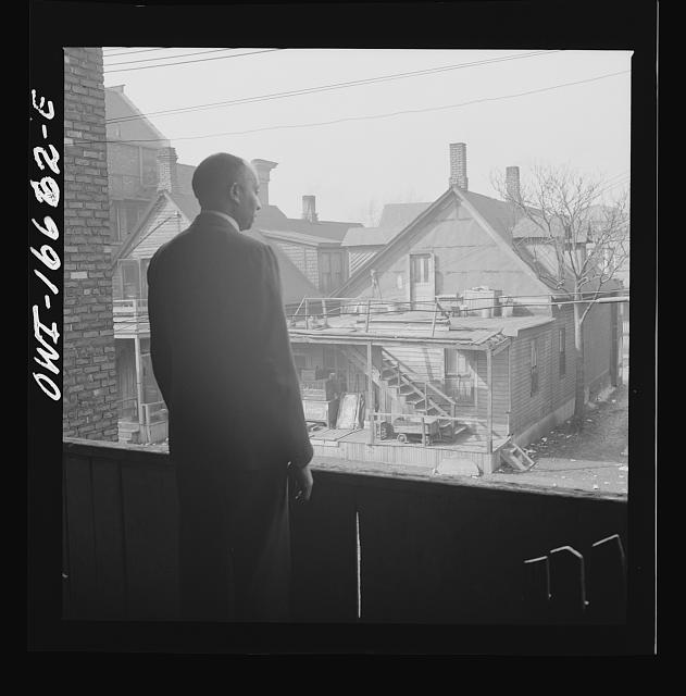 Detroit, Michigan. Looking over slum houses. These are conditions under which families originally lived before moving to the Sojourner Truth housing project.  February 1942