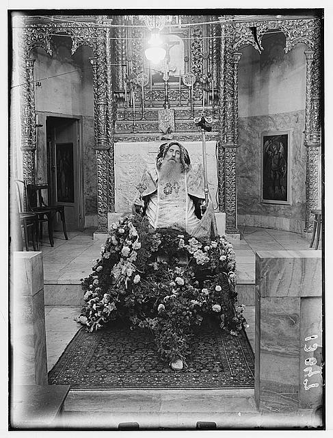 Syrian bishops remains (funeral). Corpse seated in church.  (Between 1940 and 1946)