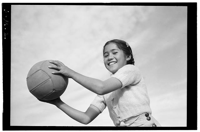 Girl and volley ball, Manzanar Relocation Center, California / photograph by Ansel Adams.