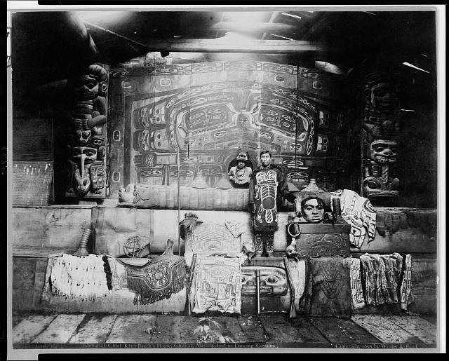 Interior of Chief Klart-Reechs house. Chief in dancing costume.  Chilcat, Alaska.  c. 1895