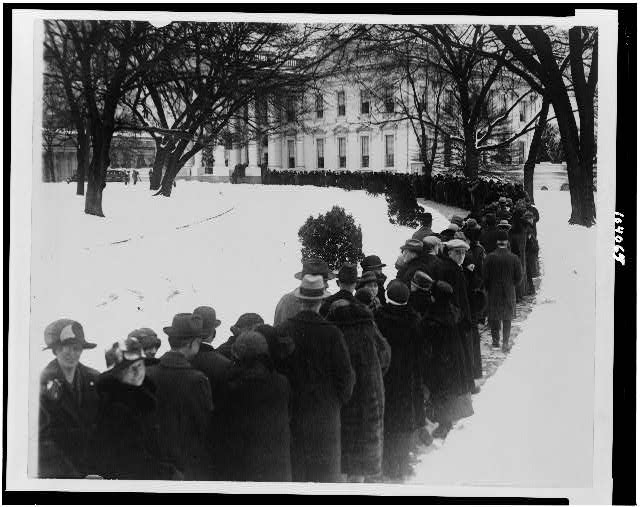 Crowd waiting in line outside of White House for New Year reception.  (Some time between 1909 and 1932)