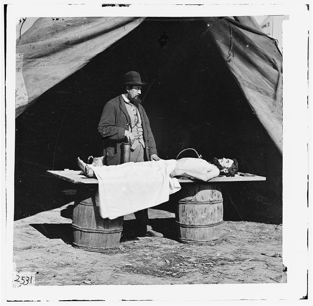 Unknown location. Embalming surgeon at work on soldiers body.  Forms part of Selected Civil War photographs, 1861-1865 (Library of Congress)