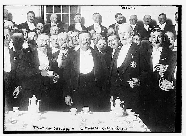 T.R. at the banquet-City Hall, Copenhagen. Group of men all in formal dress.  c. 1910