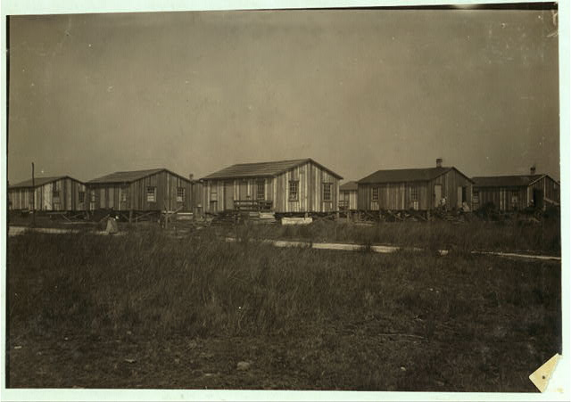 Housing conditions in the settlement of workers in Alabama Canning Co. Two families to a house, but they are separated. Housing conditions fairly good. Location: Bayou La Batre, Alabama.  1911 February.   Lewis Wickes Hine, photographer.