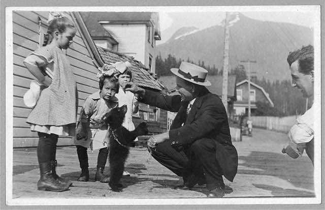 White people with bear cub (Alaska) between c.1900 and 1930 (Library of Congress)