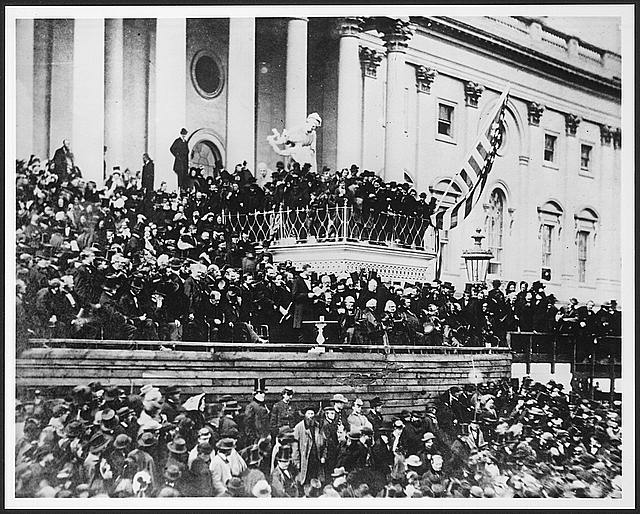 President Abraham Lincoln, 16th President of the United States (1861 - 1865), delivering his second inaugural address on the east portico of the U.S. Capitol, March 4, 1865.