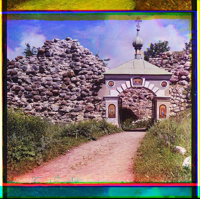 Entrance into the yard of the Church of Saint George. Staraia Ladoga, Russian Empire.  (1909)