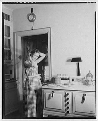 Model preparing breakfast some unidentified time between 1920 and 1950.