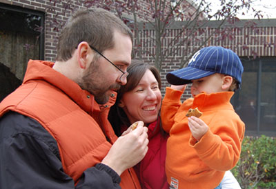 Katie's son Noah says that this is his favorite family picture (taken when he was just 2 1/2) because he and his dad are both wearing their favorite color, orange.