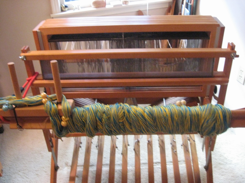 Warp is wrapped around breast beam in preparation of sleying dents. Loom is dressed from front to back in this case.