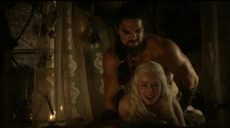 Khal Drogo (Jason Momoa) takes his wife Daenerys Targaryen (Emilia Clarke) hardly from back