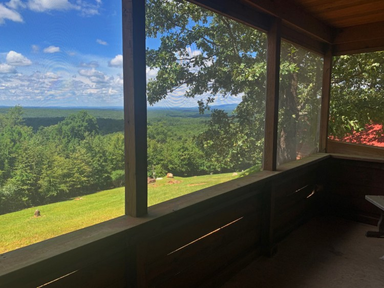 Mountain views from screened in porch at mountaintop cabin