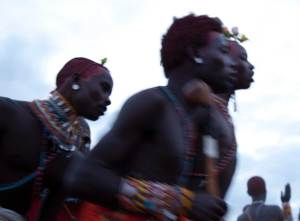 Marcy Mendelson, The Samburu Story | Samburu moran (warriors) celebrate their graduation into senior status with singing and dancing through the night. Outside Kisima village, Samburu, Kenya. August 22, 2013.