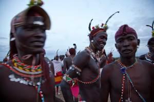 Marcy Mendelson, The Samburu Story | Samburu moran (warriors) in a celebratory mood following their graduation ceremony into senior warrior status. Outside Kisima village, Samburu, Kenya. August 22, 2013.