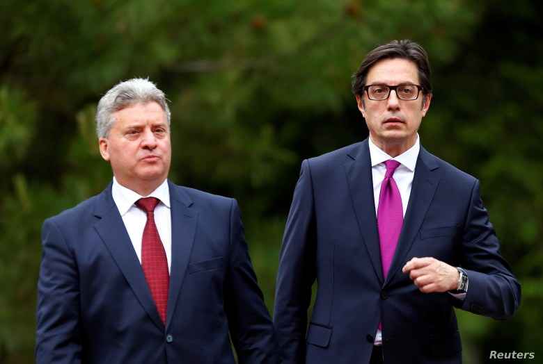 Newly elected President of North Macedonia Stevo Pendarovski walks with outgoing president Gjorge Ivanov, during his inauguration ceremony in Skopje, North Macedonia, May 12, 2019.