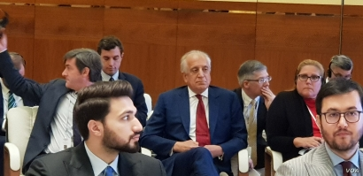 U.S. Special Representative for Afghanistan Reconciliation Zalmay Khalilzad, center, with red tie, attends the opening of the intra-Afghan dialogue before leaving Afghans to talk among themselves, in Doha, Qatar, July 7, 2019. (A. Tanzeem/VOA)
