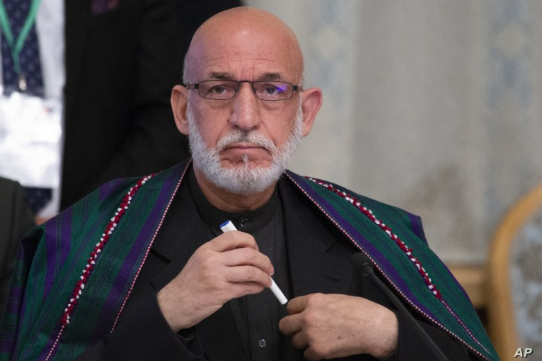 Former Afghan President Hamid Karzai prepares to attend a meeting in Moscow, Russia, Tuesday, May 28, 2019. Mullah Abdul Ghani Baradar and a team of 14 Taliban are headed to Moscow where they are scheduled to meet other Afghans including former…