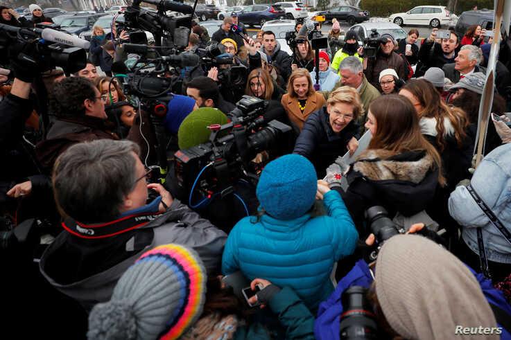 Democratic 2020 U.S. presidential candidate and U.S. Senator Elizabeth Warren (D-MA) greets supporters outside a polling site…