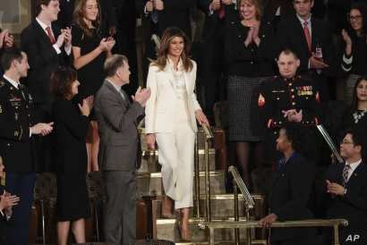 First lady Melania Trump ignored the rule against wearing white after Labor Day by appearing in a white pantsuit at the 2018 State of the Union address in Washington, Jan. 30, 2018.