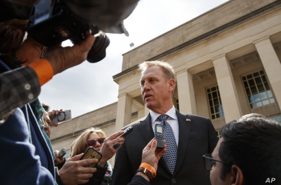 Acting Defense Secretary Patrick Shanahan talks to the media before the arrival of French Defense Minister Florence Parly at the Pentagon, March 18, 2019.