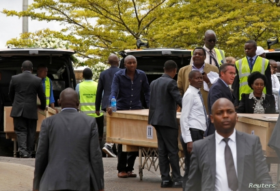 Pallbearers receive coffins of the victims of March 10 plane crash of Ethiopian Airlines' flight ET 302, as they arrive at the…