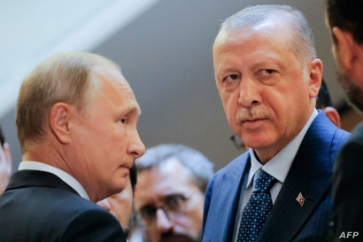 Russian President Vladimir Putin, left, and Turkish President Recep Tayyip Erdogan wait to enter a hall during their meeting at the Bocharov Ruchei residence in the Black Sea resort of Sochi, in Sochi, on Sept. 17, 2018.