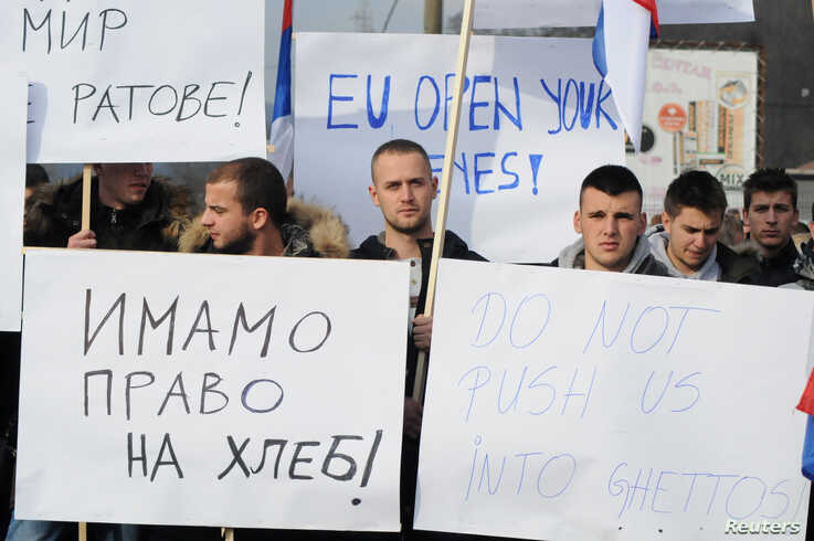 People protest after Kosovo's decision to raise customs tariffs on Serbian and Bosnian goods, in the village of Rudare near…