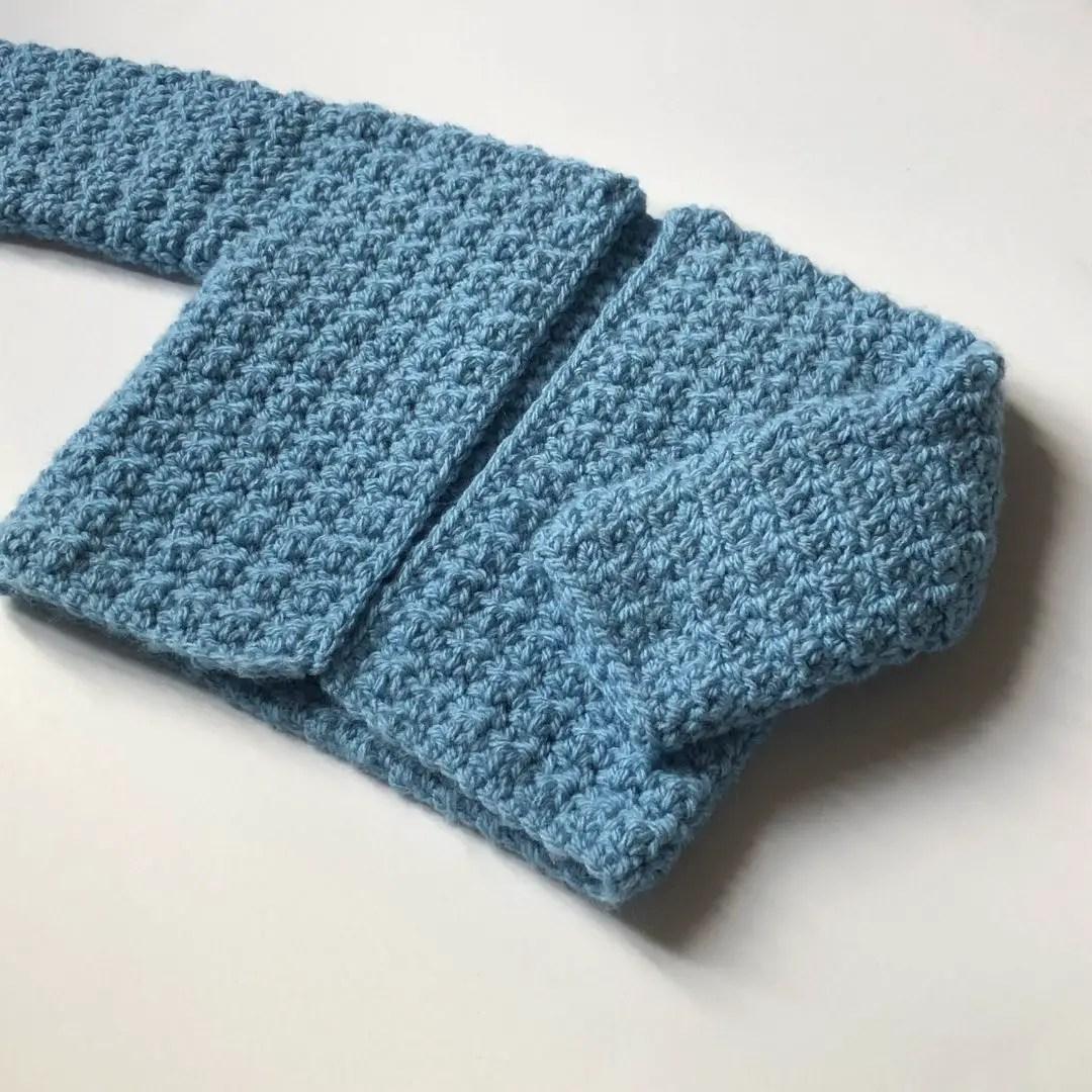 Free crochet baby sweater pattern - Harmony Sweater designed by Kristine from Ambassador Crochet