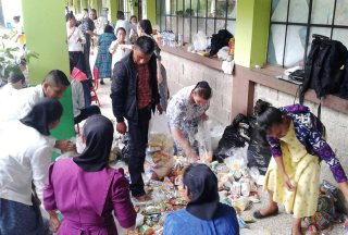 Sorting relief goods for volcano eruption victims.