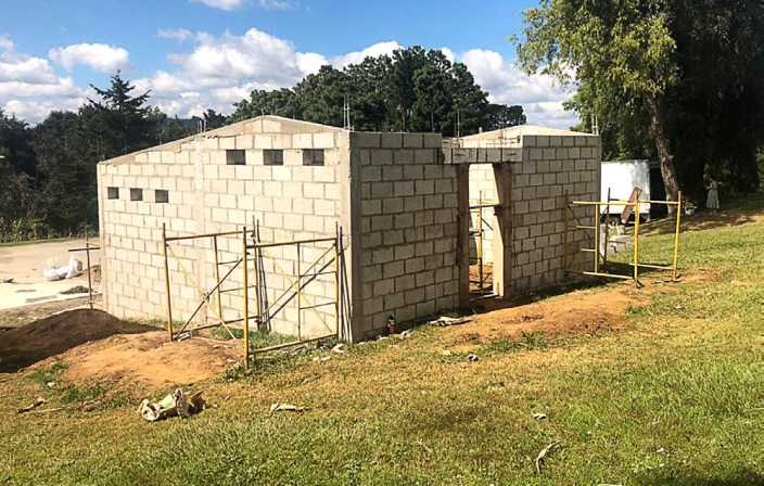 The new restroom facilities stand directly behind the institute facility.