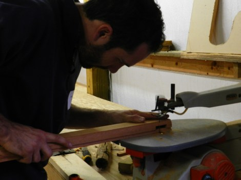 Routing out the wood to assemble the new parts of the sash.