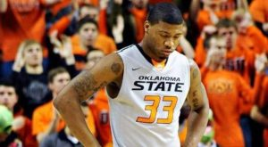Oklahoma State's Marcus Smart Pushes Fan