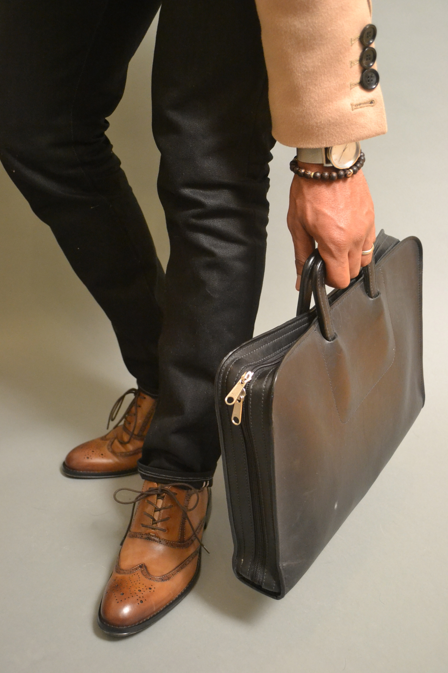 Sabir in Aston Grey Wingtips, 3x1 black jeans, tobox bracelet & korchmar briefcase