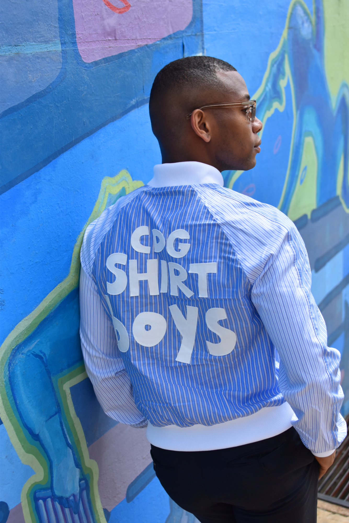 Sabir M. Peele of Men's Style Pro wearing Comme des Garcons Shirt Bomber Jacket