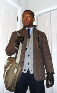 About to Step out into the Cold: Tweed Jacket by Tivulo (Thrifted) | Leather Gloves Thrifted | Navy Cord by Tommy Hilfiger | Griffin Crest Tie by Lands End Canvas | Shirt by Club Room | Cardigan by HM | Canvas Laptop Case Thrifted via Ebay