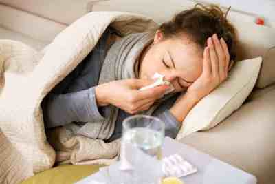 Sick woman blowing nose. - how to stay healthy during the winter