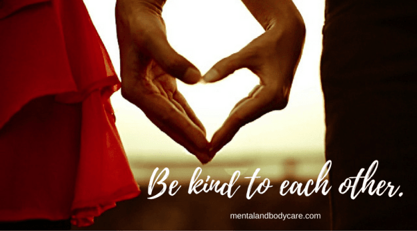 Hands forming heart, be kind to each other. A New Year's resolutions list