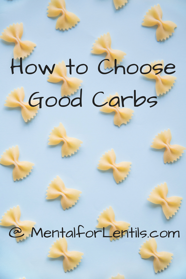 Dry bow tie pasta pieces on blue background with text overlay - How to choose good carbs