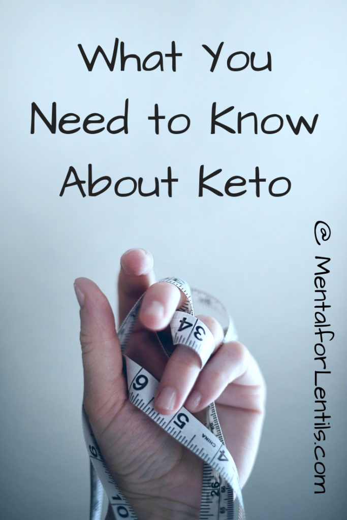 Hand with measuring tape interlaced with fingers with text overlay - what you need to know about keto.