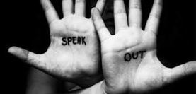 Black and white image of two palm facing up with words Speak and Out on each palm - About being bullied in the work place