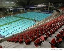 Coloured image of a large community swimming pool and auditorium