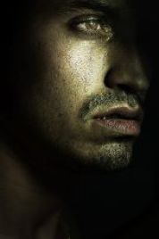 Grey scale image of man's face, tears running down. Men's mental health matters!