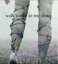 Black and white image of legs wrapped in barbed wire - moving on through abusive relationships