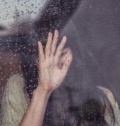 girl crying at window