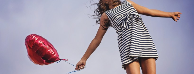 joyful girl holding a balloon