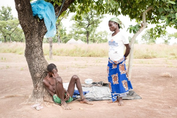 Man chained to a tree in Ghana – Photo by Robin Hammond, The Guardian, Feb 3/20 – small, low-resolution version included as fair use
