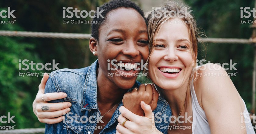 women smiling and hugging