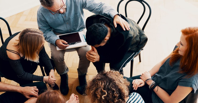 teens in group therapy session