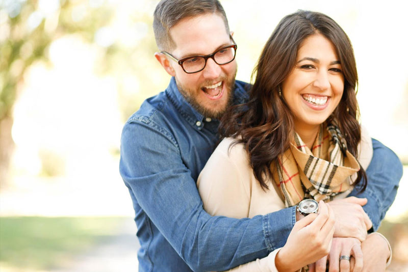 Mental Health Benefits of a Healthy Sex Life - Blog Post Image - Picture of Man and Woman Laughing - Mental Health Foundation