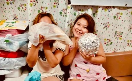 Camera Shy - Migrants at Bethune House enjoy HKK's Home Baked Breads
